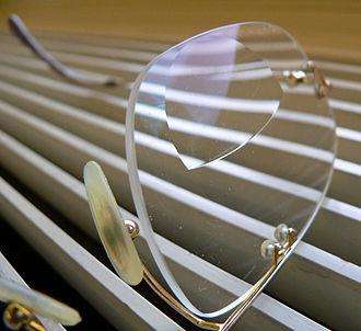 Corrective lens - A bifocal corrective eyeglass lens