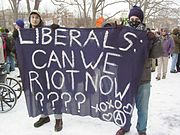 Blac bloc participants at the 2005 counter-inauguration taunting liberal non-violent protesters.