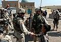 Brigade Combat Team with voter in Iraq.jpg