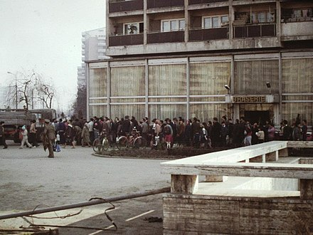 A line for the distribution of cooking oil in Bucharest, Romania in May 1986 Bucur Obor (1986).jpg