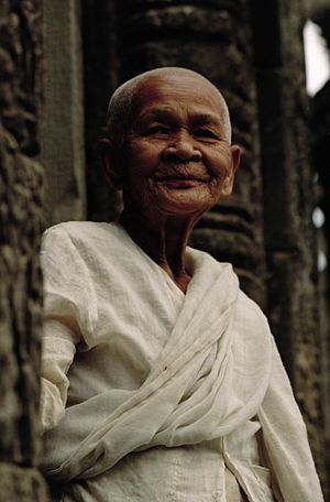 Buddhism in Cambodia - Buddhist nun. Bayon Temple, Angkor Wat, Siem Reap, Cambodia (January 2005).