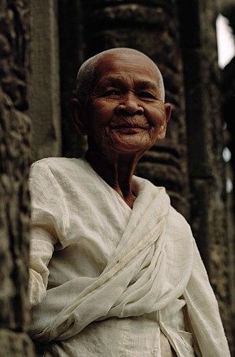 Buddhism in Cambodia - Buddhist nun. Bayon Temple, Angkor Wat, Siem Reap, Cambodia (January 2005).