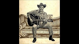 Buddy Williams (country musician) - Buddy Williams poses for a photo with a Swedish Manufactured Levin Guitar. Circa 1950.