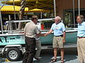 Buffett Boat Keys handed to USFWS Captian Bob Quarles (4819553167).jpg