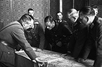 German–Soviet Border and Commercial Agreement - Soviet and German officers at the demarcation line examine a map