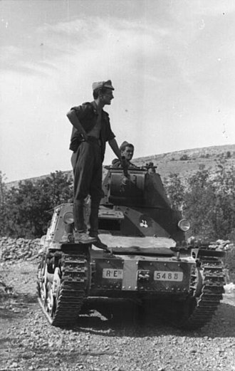 "13th Infantry Division Re - Italian armored car with sign ""Re"" in Yugoslavia, August 1943."