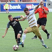 bf0b668ae Corben Bone of Cincinnati and Niall McCabe of Louisville fight for the ball  in the 2017 U.S. Open Cup