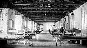 Civilian Public Service - In large CPS dormitories, each man had a cot, simple desk with chair and a narrow set of shelves for personal possessions.