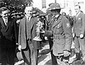 Calvin Coolidge receiving statue of Boy Scout outside the White House 1927.jpg