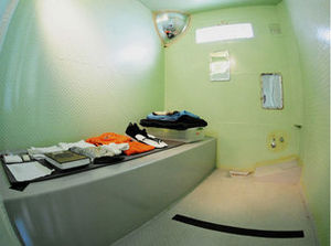 Camp Five Echo - A wide-angle view of a cell in Camp Five Echo taken by a navy photographer released by the detention center, which stated that the photograph was taken Dec. 8, 2011.