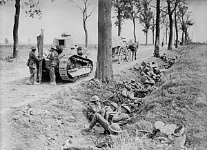 Hundred Days Offensive - Canadian troops shelter in a ditch along the Arras-Cambrai road.