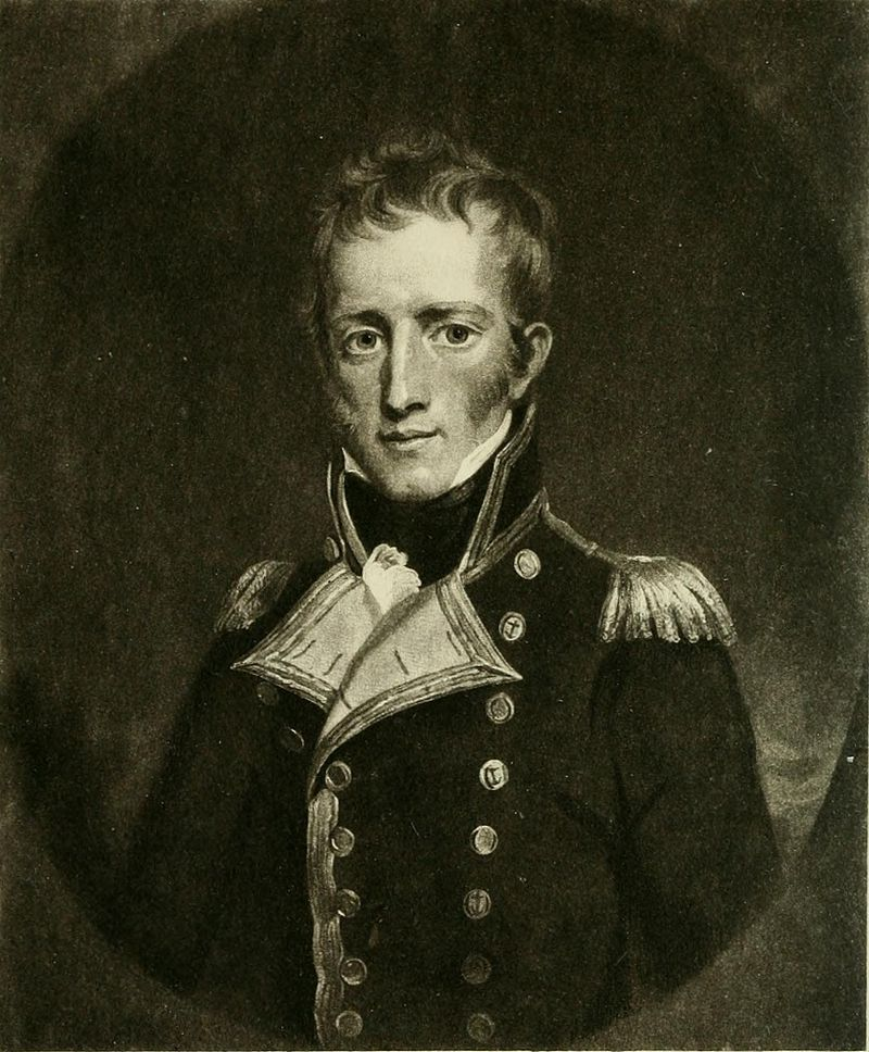 Half-length oval portrait engraving of a man in a gold buttoned coat and epaulettes, with tousled hair and sideburns.