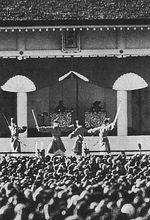 Hakkō ichiu - Emperor Shōwa and Empress Kōjun presiding the celebration of the 2600th anniversary of mythical foundation of the Empire in November 1940.