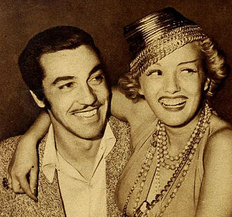 Cesar Romero - Romero with actress Phyllis Brooks, c. 1940