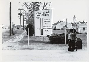 "Fort Chaffee Maneuver Training Center - This sign, titled ""New Horizon"" in front of Fort Chaffee showed the number of Vietnamese and Cambodian refugees who had lived at the camp and had been subsequently resettled, as well as the number still living there."