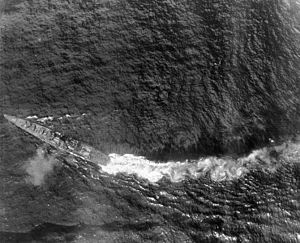 Japanese cruiser Chikuma (1938) - Chikuma under aerial attack during Battle off Samar in the Battle of Leyte Gulf, 25 October 1944. The ship's stern has been severely damaged by a torpedo hit, but the ship's outboard propellers are still keeping her somewhat moving.