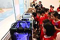 Children viewing MinNature 3D Printing upclose.jpg