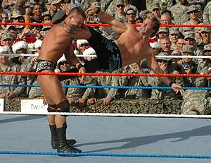 WWE Tribute to the Troops - Chris Jericho performs an enzuigiri on Randy Orton during the 2007 Tribute to the Troops