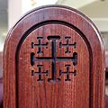 Christ the King Catholic Church (Ann Arbor, Michigan) - interior, Jerusalem cross on a pew.jpg