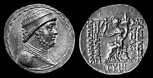 "Mithridates II of Parthia -  Early coin of Mithridates II the Great of Parthia from Seleucia on the Tigris. The reverse shows a seated goddess (perhaps Demeter) holding Nike and a cornucopia. The Greek inscription says ""Coin of the Great king Arsaces, friend of the Greeks"""