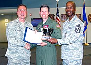 Col. Clint Crosier, 460th Space Wing commander, Lt. Col. Shawn Fairhurst, 11th Space Warning Squadron commander, and Chief Master Sgt. Robert Ellis, 460th Space Wing command chief, pose with the Gen. Seth J. McKee trophy