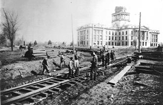 Nebraska State Capitol - Workers lay track for the Capitol Railroad around the second state capitol, March 1922.