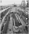 Construction of caisson for Shipbuilding Dock. General view looking east. - NARA - 299635.tif