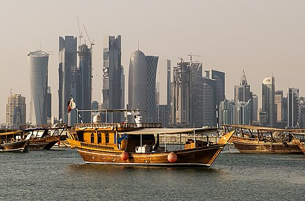 Traditional dhows in front of the West Bay skyline as seen from the Doha Corniche. Corniche Doha Qatar.jpg