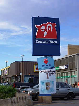 Alimentation Couche-Tard - Sign of a Couche-Tard store in Montreal, Quebec