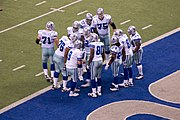 Cowboys huddle