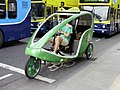 Cycle rickshaw on O'Connell Street, Dublin.JPG