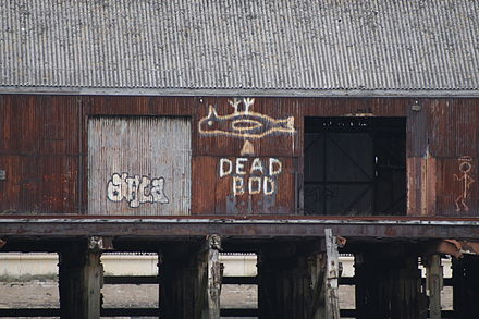 """Dead Bod"" mural in original location on a jetty at Alexandra Dock Dead Bod (geograph 4427797).jpg"