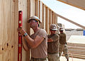 Defense.gov News Photo 100428-M-3256G-005 - U.S. Navy Seabees from Naval Mobile Construction Battalion 133 s Detail Delaram II place walls during the construction of a Southwest Asia hut at a.jpg