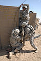 Defense.gov News Photo 100916-F-9631D-008 - U.S. Army soldiers with the 864th Engineer Battalion assigned to Combat Outpost Terminator continue a second day setting up HESCO barriers to.jpg