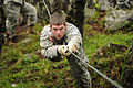 Defense.gov News Photo 110608-A-CL600-286 - U.S. Army Sgt. Johnathan Oberholz an infantryman with Charlie Troop 2nd Squadron 106th Cavalry Regiment crosses a one-rope bridge during an.jpg