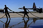 Defense.gov News Photo 120627-F-IG195-601 - U.S. Air Force airmen with the 302nd Airlift Wing prepare to stow a fire hose after filling a Modular Airborne Firefighting System MAFFS II aboard a.jpg