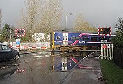 Dingwall Middle Level Crossing - 158 crossing (11119700983).jpg