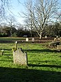 Distant seat in the churchyard at St Mary the Virgin, Apuldram - geograph.org.uk - 1637298.jpg