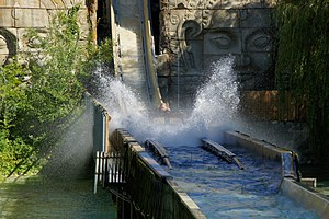 Log flume (ride) - Dragon Falls at Chessington World of Adventures, Surrey, UK.