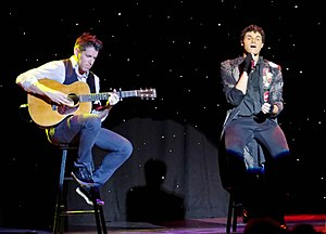 EJay Day - Day performing on the cruise ship MS Veendam in 2012 (with an unidentified guitar player on his left)