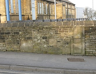 Eccleshill, West Yorkshire - The remains of gateposts to Eccleshill Hall embedded in a wall