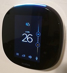 Ecobee4 on the wall from an angle showing home screen.jpg