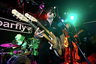 Ed Harcourt - Ed Harcourt with Wild Boar at The Barfly Club, Camden, August 2005. In shot – Dimitri Tikovoi on drums, Andre Shapps on bass. Out of shot, Emett Elvin, guitar