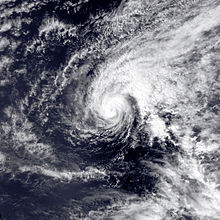 Satellite image of Hurricane Ekeka in open sea. The tropical cyclone is somewhat elongated in appearance and has a visible albeit inconspicuous eye
