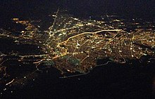 Aerial view of El Paso, Texas and Ciudad Juárez, Chihuahua; the brightly lighted border can clearly be seen as it divides the two cities at night.