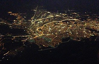 Mexico–United States barrier - Aerial view of El Paso, Texas, (top and left) and Ciudad Juárez, Chihuahua, (bottom and right). The brightly lit border can clearly be seen as it divides the two cities at night. The dark section at left is where there the border crosses Mount Cristo Rey, an unfenced rugged area.