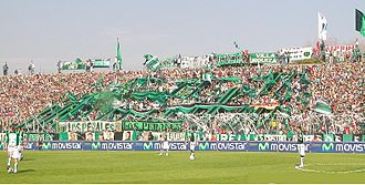 Barra brava - Members of barras bravas are often found scattered between the flags that display. In the picture, barra brava of Club Atlético Nueva Chicago, from Argentina.