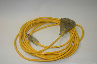 Extension cord flexible electrical power cable with a plug on one end and one or more sockets on the other end
