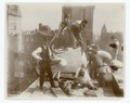 Exterior marble work - construction workers positioning a piece of marble on the roof, looking east (NYPL b11524053-489535).tiff