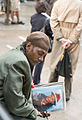 FEMA - 32644 - Photograph of 9-11 mourner at memorial service by Andrea Booher.jpg